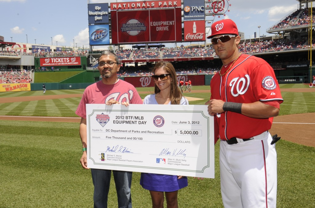 On Sunday, June 3, the Washington Nationals partnered with the Baseball Tomorrow Fund to present a $5,000 grant to the D.C. Department of Parks and Recreation in support of youth baseball and softball programs. Nationals shortstop Ian Desmond and Fund Senior Grant Coordinator Meghan Chisholm awarded the grant to DPR Director Jesus Aguirre on the field prior to the team's afternoon game against the Atlanta Braves. A portion of the donation will be used directly for the King Greenleaf Recreation Center in Southwest D.C. (Photo courtesy of the Washington Nationals)