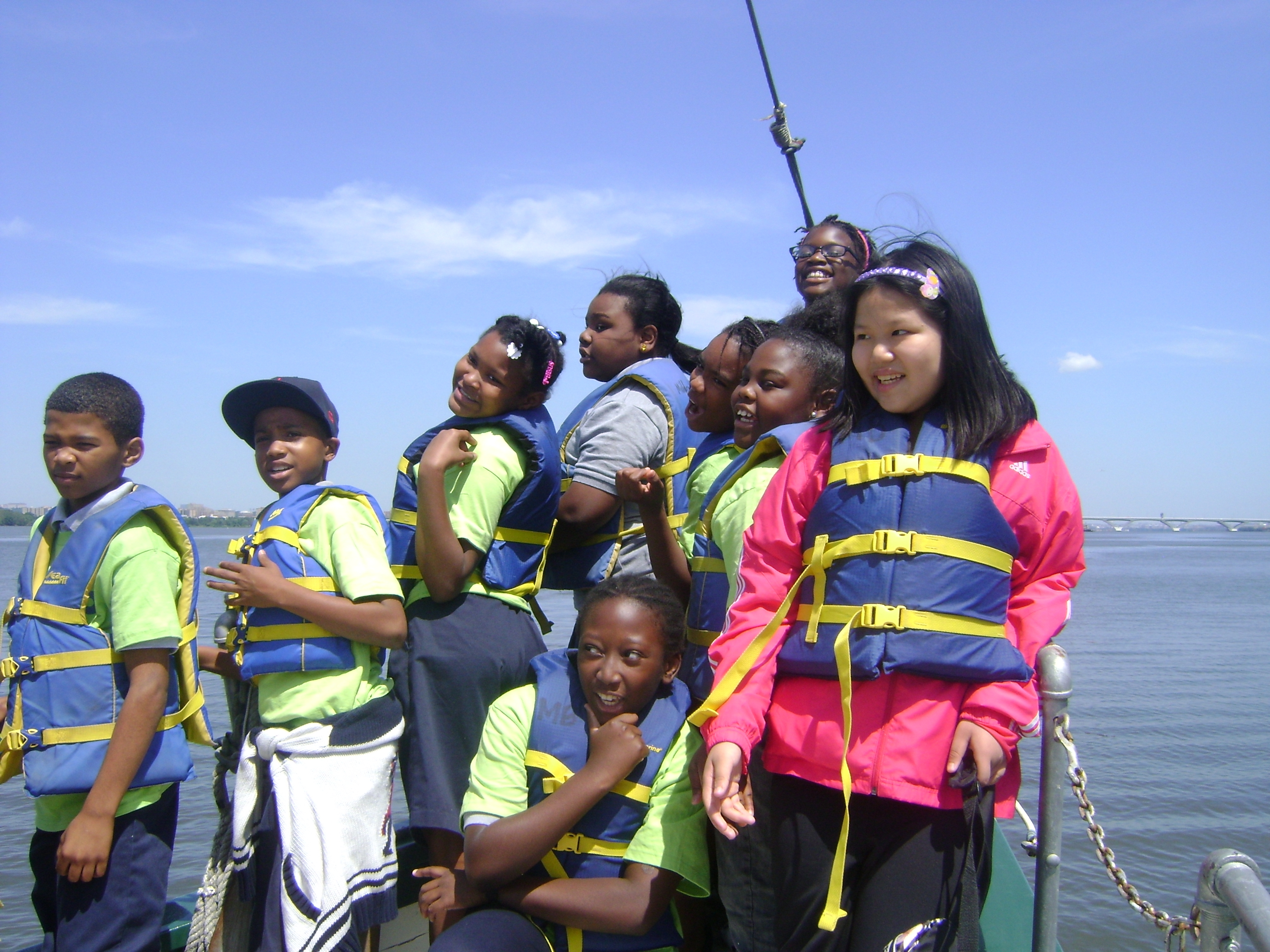 4th Graders enjoy the open water. Left to Right: Dajun Miller, Nazr Harper, Tonya Crumle, Kya Hopkins, Courtney Thompson, Tasia Bailey, Jennifer Zhou, Joniah Williams (behind), and Eugene O'Carroll (front center) (Photo: Eric Fishman).