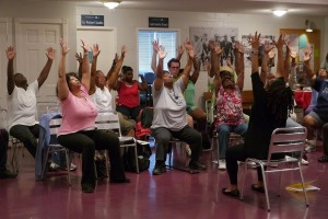 Healthy U participants try out yoga poses with instructor Kiamsha Leeke on June 9, 2012. Photo by Lucia Effros.