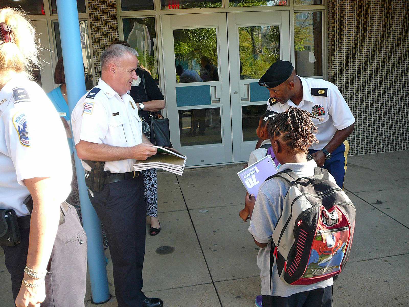 Commander Hickson and Command Sergeant Major Jessup welcome students on first day at Amidon-Bowen (Photo by Perry Klein)