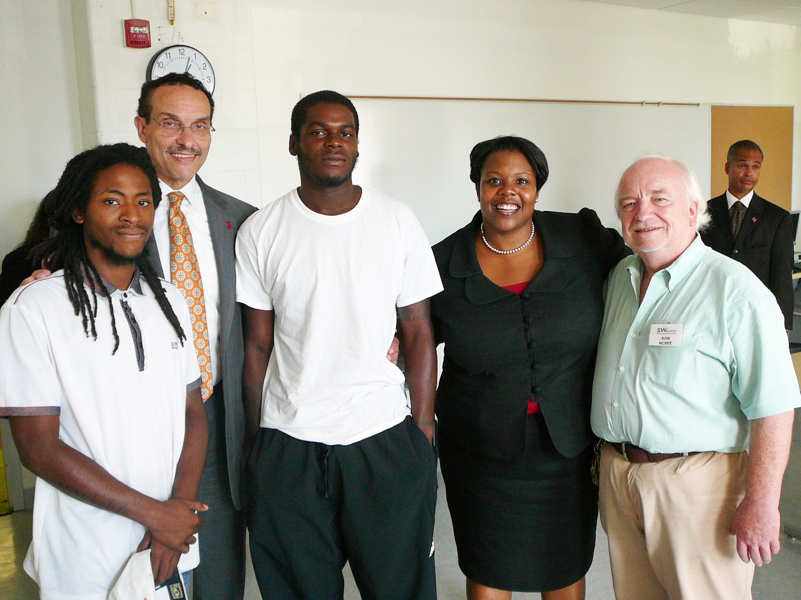 Mayor Vincent Gray (2nd from left) and Chancellor Kaya Henderson (2nd from right) visit the new Computer Lab installed by SWNAs Technology Task Force interns Duane Patterson (far left) and Andre Wilkinson (3rd from left).  Andre, now 21, attended Amidon in grade school.   ANC 6D Commissioner Ron McBee is on the right.  The 25 computers were among over 200 donated to SWNA by the American College of Obstetricians and Gynecologists, located in Southwest Washington. (Photo by Perry Klein)