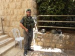 An Israeli soldier in Bethlehem smiles for a photo