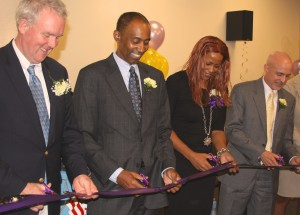 Ward 6 Councilmember Tommy Wells, Chief Judge of the DC Superior Court Lee Satterfield, Director of the DC Superior Court's Family Court Social Services Division Terri Odom, and Family Court Deputy Presiding Judge Hiram Puig-Lugo participate in the formal ribbon-cutting.