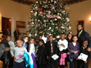 Amidon-Bowen 2nd & 3rd graders in front of a White House Christmas tree.: L to R: Kareem Cook, Zaniya Gansis, Khalil Crutchfield, Bryelle Thompson, Shalissa Buttle, Derrick Moss, Aleja Fisher, Tyauna Gray, Gianna Marchall, ZaeQuan Green, Mr. Thomas. (Photo: Lavanya Poteau)