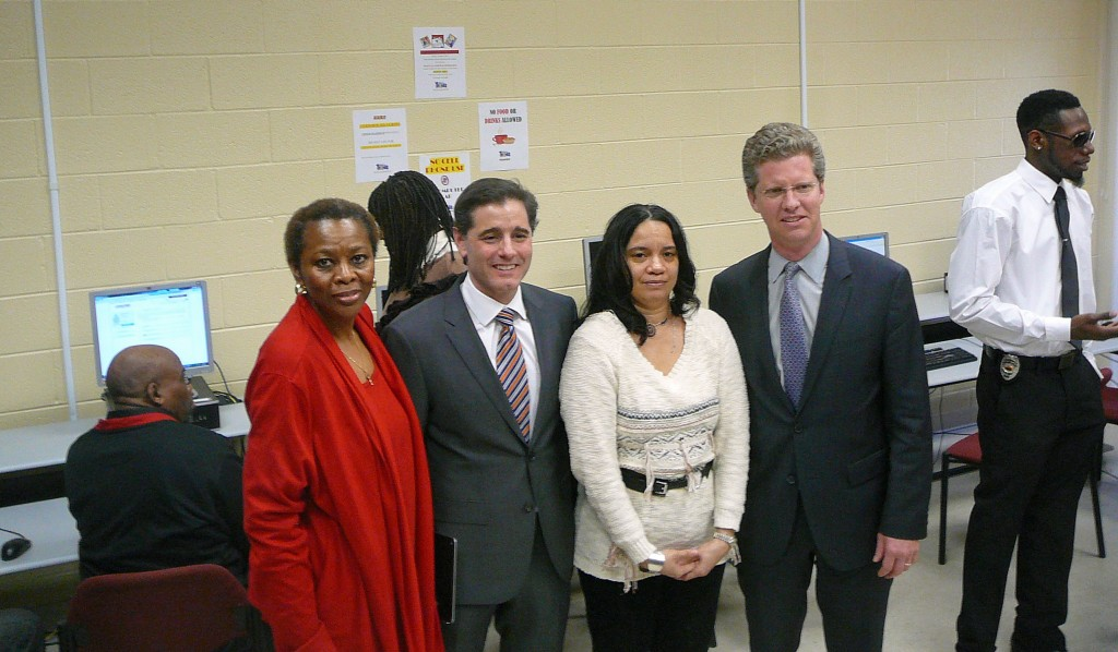 From left to right: Southwest community activist Thelma Jones; FCC Chairman Julius Genachowski; Beverly, a recent trainee in SW who recently completed her training as a Certified Microsoft Specialist; and HUD Secretary Shaun Donovan in the computer lab at the Southwest Family Enhancement Center at Greenleaf Gardens.